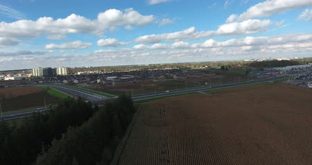 serpenyő : Drone Ascending Over Farmers Field With City In Background Stock mozgókép