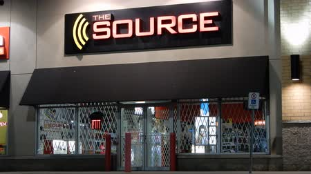 retailer : 4K The Source Store Front At Night