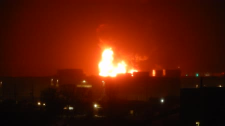 сжигать : Big Flames Burning Building At Night With Fire Trucks And Hoses Spraying Water 2