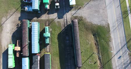 caboose : Flying Over Trains On Rails Straight Down View 4K