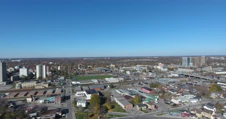 yoksulluk : Panorama Of Smaller Downtown City Core Then Flying Over 4K Stok Video