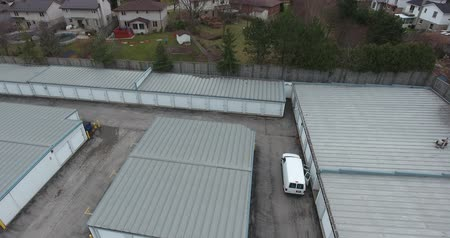 homlokzatok : Storage Company Aerial View with Grey Storage Units Drone Shot