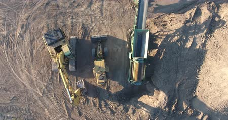 yükleyici : Construction Machinery Excavator and Front End Loader Drone Aerial Top Down View 2