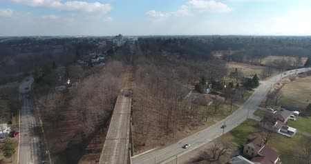 prkna : Flying Over Abandoned Bridge Into Town Aerial