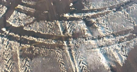 vacant : Flying Over Parking Lot With Tire Tracks In Snow In Winter Aerial View
