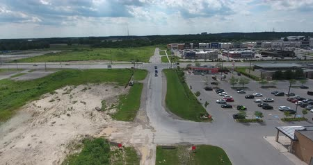 vacant : Flying Over Shopping Complex With New Dirt Parking Lot Near A&W Hamburger