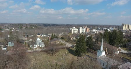 чаща : Panorama Of Cemetery By Church Near Small Town Aerial In Early Spring Стоковые видеозаписи