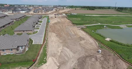 eye : Construction Of New Road Over Stream By New Housing Development Aerial