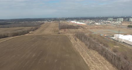 Farmland Aerial In Early Spring On Overcast Day By Suburbs 4K Stok Video