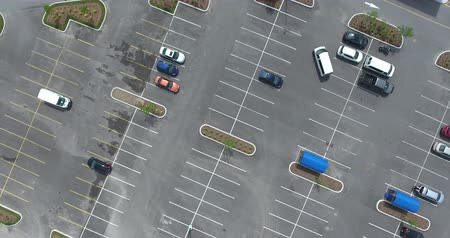 vacant : Fast Spinning Aerial Of Cars In Parking Lot Stock Footage
