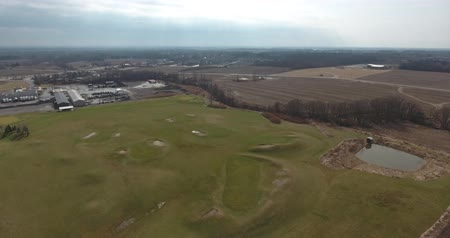 тройник : Flying Over Golf Course Just After Winter 4K Стоковые видеозаписи