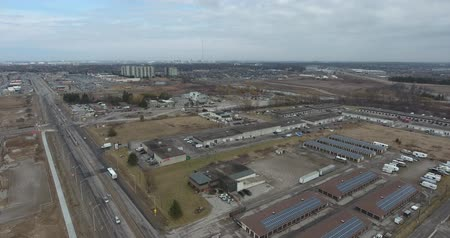 eye : Industrial Complex Buildings With Solar Panels Aerial Flyover 4K Stock Footage