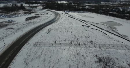 harikalar diyarı : Flying Along Open Road Between Snow Covered Farm Fields Aerial
