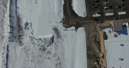harikalar diyarı : Flying Near Building Parking Lot And Snow Covered Field Aerial