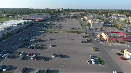 серый фон : Flying Over Parking Lot In Strip Mall During Day Aerial View 003 Стоковые видеозаписи