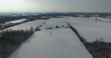 lombhullató : Flying Over Snow Covered Farm Fields In Winter With Cloud Shadows On Ground Aerial