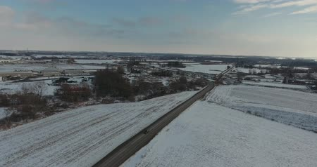 harikalar diyarı : Flying Over Snow Covered Farmers Fields Towards Road Drone Aerial View 002