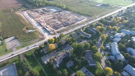dach : Flying Towards New Construction Site Near Residential Area Aerial View