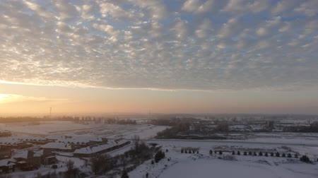altostratus : Golden Sunrise With Large Clouds Over Snowy Town Aerial Timelapse