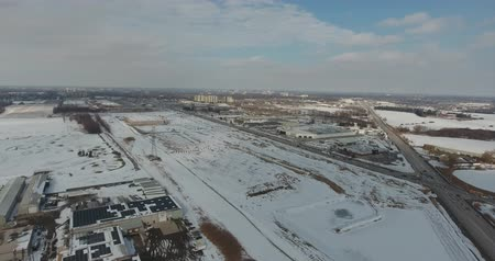 harikalar diyarı : Low Panorama Of Industrial Section And Farmland In Winter Time Aerial View