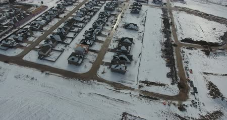 szerény : Pan And Tilt Up Of New House Construction In Winter Aerial