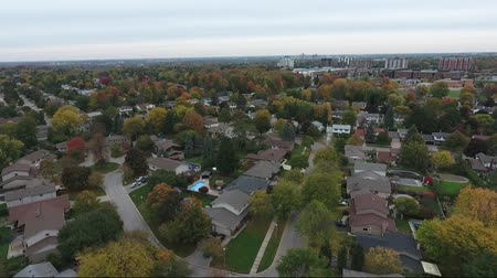 пригород : Pan Of Middle Class Neighborhood Towards Apartment Complex In Distance Aerial View
