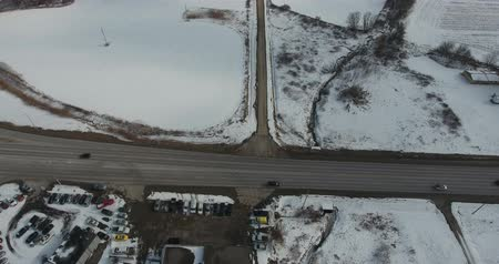 harikalar diyarı : Traffic Driving On Road In Winter Near Industrial Section Aerial View Stok Video