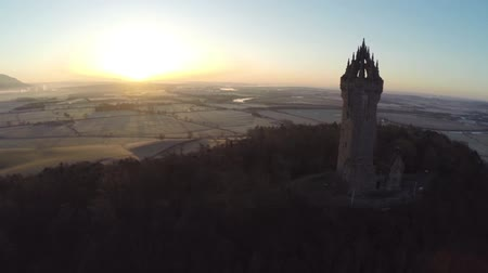 william : Aerial shot of the Wallace Monument in Scotland early on a summers morning with good light flare