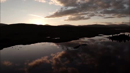 wielka brytania : Aerial shot over Rannoch moor in Scotland revealing a desolute and baron landscape during sunset