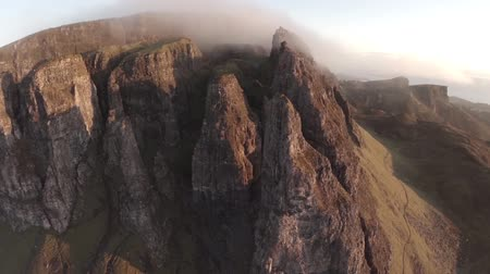 skotsko : Aerial shot of the Quairang in Skye (Scotland) with morning light revealing dramatic landscape of the Needle Dostupné videozáznamy