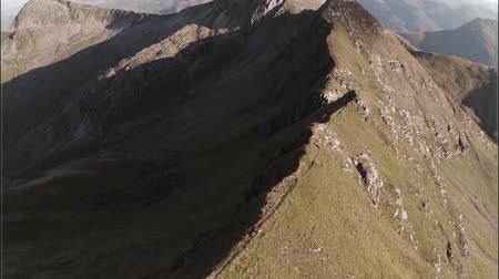 coe : Spectacular aerial shot on Sgurr aMhaim mountain revealing devils ridge in the Scottish highlands during sunset Stock Footage