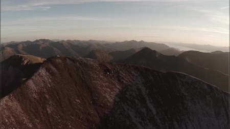 coe : Spectacular aerial shot on Sgurr aMhaim mountain in the Scottish highlands during sunset