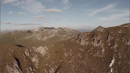 coe : Spectacular aerial shot on Sgurr aMhaim mountain revealing the Ring of Steall in the Scottish highlands during sunset