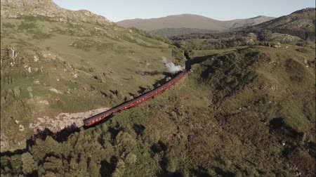 lokomotif : Aerial shot of the Jacobite Steam Train going through stunning scenary in the Scottish highlands
