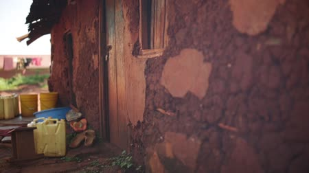 malawi : A traditional African hut mad from wood and mud in a slum in Uganda Stock Footage
