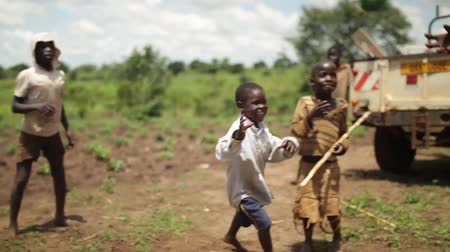 Кения : 5 young happy African boys playing with a ball in rural Uganda Стоковые видеозаписи