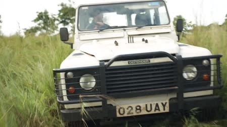 malawi : A Landrover drives down an overgrown dirt track in rural Uganda, Africa