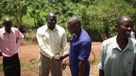 malawi : African men celebrating the installation of a new water well in rural Uganda, Africa Stock Footage