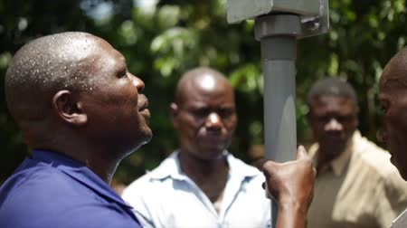 malawi : African men installing a new water well in rural Uganda, Africa Stock Footage