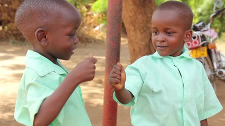 afro americana : Two happy African school children fist pumping