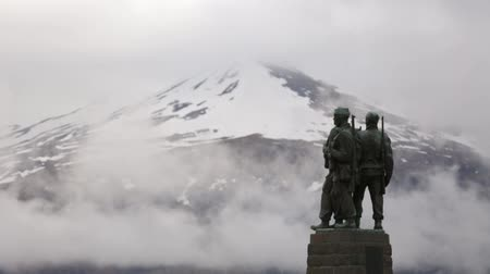 savaş : War memorial at Spean Bridge in the Scottish highlands with clouds, snow and mountains in the background