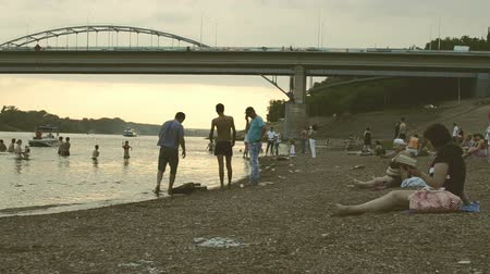 Russian people relaxing in Ufa Bashkortostan on the banks of the White River that flows through the city Stock Footage