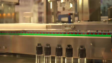 dispensing : Industrial robot for dispensing of medicines in bottles with subsequent screwing sealed cover Stock Footage