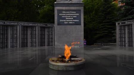 памятники : 11 June 2018. Russia. The City Of Domodedovo. Day. Obelisk of Glory to soldiers-Domodedovo, who died during the Second world war. Eternal flame.