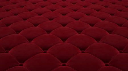 3D animation of the flight over the red quilted velvet surface. Looped video.