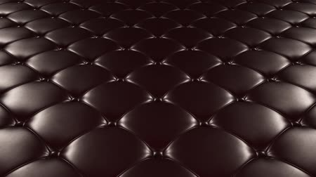 3D animation of the flight over a black quilted leather surface. Looped video. Vídeos