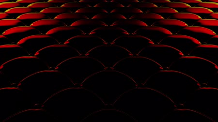 3D animation of the flight over a black quilted vinyl surface with red reflections of light. Looped video.