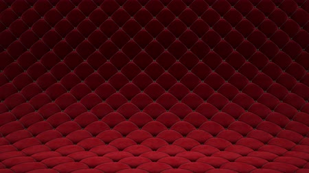 3D motion animation of red quilted velvet surface with black leather straps. Realistic animation of high quality. Looped video.
