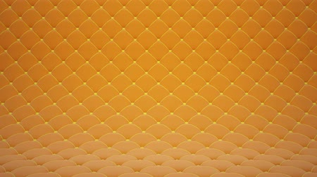 3D motion animation of orange quilted velvet surface with yellow leather straps. Realistic animation of high quality. Looped video. Filmati Stock