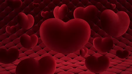 Red velvet hearts hang in the air around one big heart. Against the background of a smoothly moving quilted surface. Video loop. Vídeos